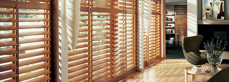 A room that uses Hunter Douglas Shutters as window treatments.